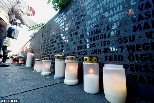 Candles are seen next to the names of victims during a ceremony to mark the 25th anniversary of a maritime disaster when MS Estonia, carrying 803 passengers and 186 crew, sank in the Baltic Sea, in Tallinn, Estonia, on September 28, 2019