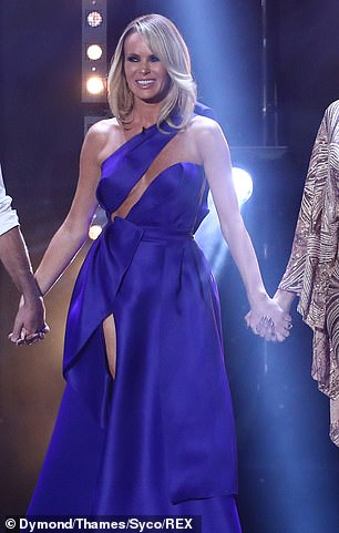 Stunning: Amanda risked a wardrobe malfunction in a striking cut-out number for the second live show