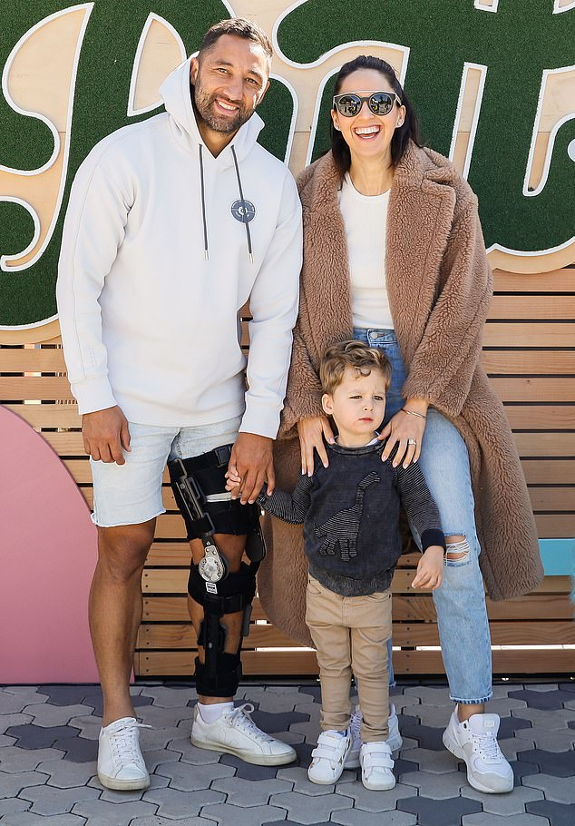 No worries! Benji Marshall was all smiles after his final game for the Wests Tigers as he spent his first day out of the NRL'sbiosecurity bubble on Monday at the launch of Pixar Putt with his wife, Zoe, and their two-year-old son, Fox
