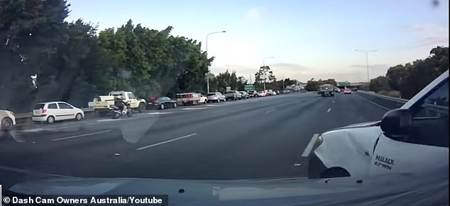 Pieces of plastic and debris from the smash were sent flying across windshields and onto the tarmac, as the three cars came to a grinding halt on the busy highway (pictured)