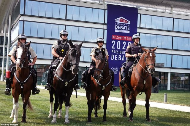 Mounted police patrol around the Samson Pavilion as workers prepare for the first presidential debate
