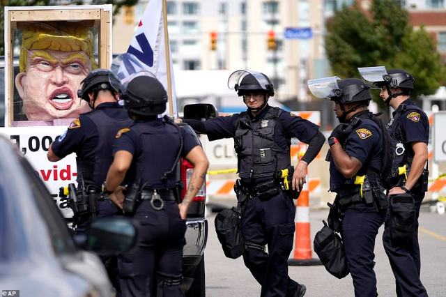 Pictures show preparations underway in the city Monday after the mayor, Frank Jackson, urged protesters to remain peaceful. Ohio Gov. Mike DeWine sent 300 members from the Ohio National Guard to the city