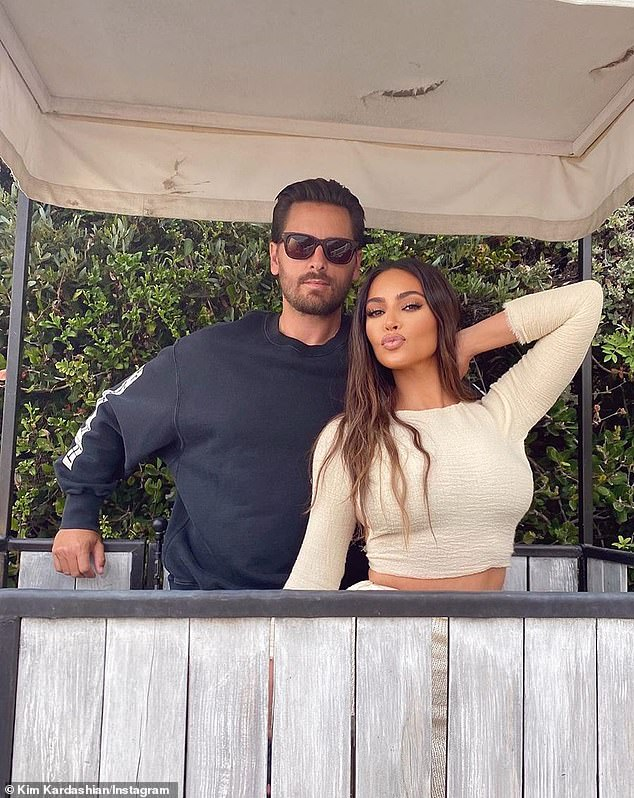 Family: Her outing comes hours after posted a snap of herself and Scott posed together at the family's $100 million beach rental in Malibu, with Kim showing off her trim midriff in a cream crop top and skirt