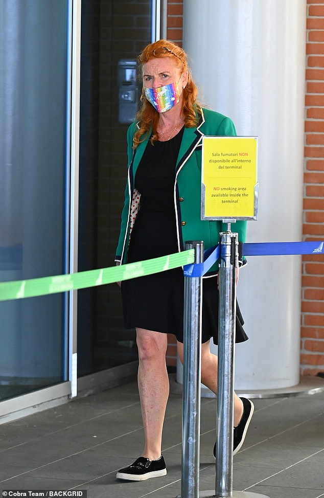 The Duchess sported a rainbow face mask adorned with white unicorns and wore her flame red hair in a half-updo with her glasses on her head