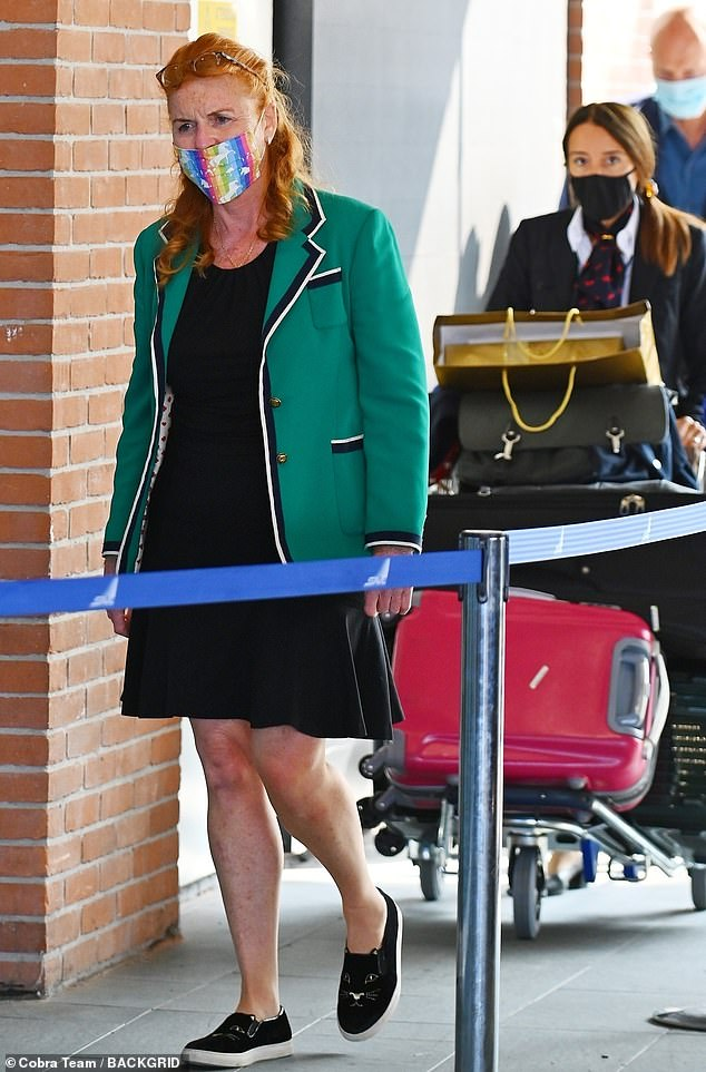 Grandmother-to-be Sarah Ferguson looked in high spirits today as she arrived at Venice airport - donning a very colourful face mask and accompanied by a very loaded luggage trolley