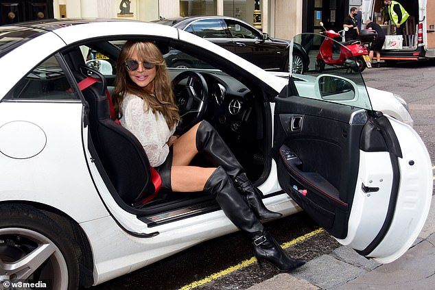 Here she comes: The online sensation caught the eye as she stepped out of her flashy white car