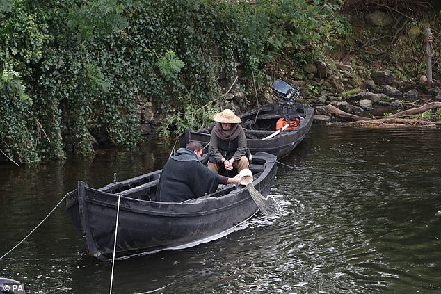 Realistic: Some extras were recently seen in a wooden boat along the river