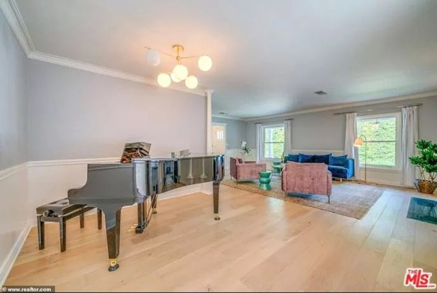 Plenty of room for a musician: The seating room has room for a large piano with hardwood floors and two windows