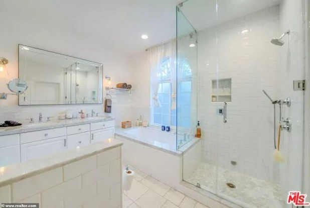 Spa Retreat: And the master bathroom offers all top amenities in the form of a double sink, a long bathtub and a steam bath