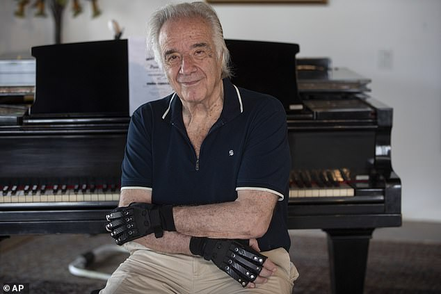 He wrote on Instagram: 'The thrill of being able to play something with the bionic gloves at home already makes me believe in a higher being'