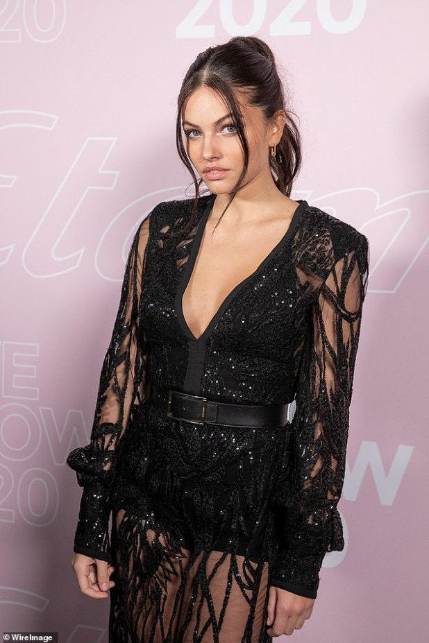 Gorgeous: Her brunette locks were styled in a chic updo with wavy strands framing her face, while a bright palette of makeup enhanced her beautiful features