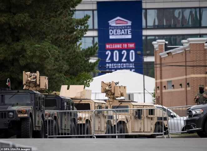 National Guard block intersections as security measures are put in place before the debate