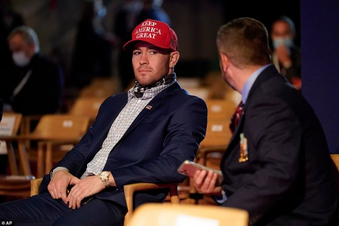 UFC fighter Colby Covington takes his seat as a guest of President Donald Trump