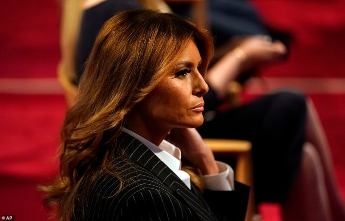Melania sits in the crowd for the debate. She originally was wearing a white face mask, but later removed it