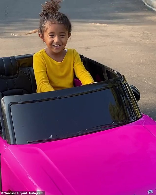 Need for speed: The toddler looked overjoyed as she rode the toy luxury SUV around their property