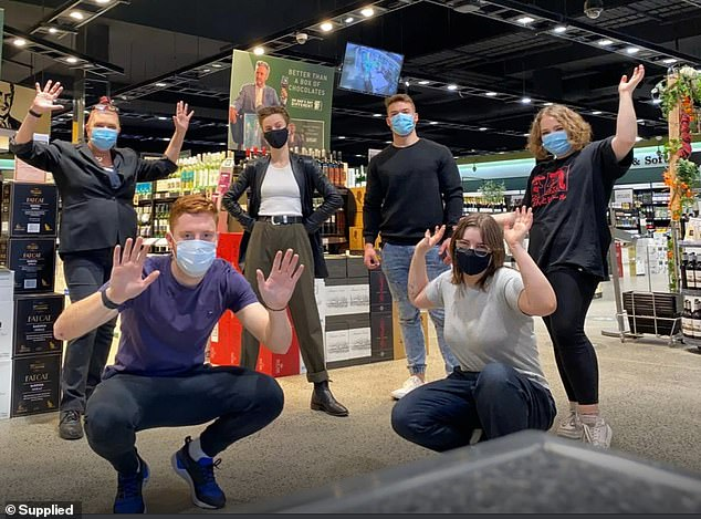 Dan Murphy's team members pose in mask at one of the retail chain's stores. The company is looking to hire more than 1,000 casual team members starting as soon as possible