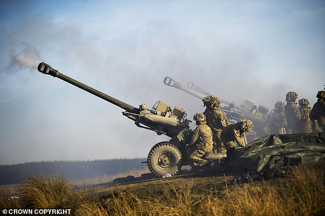 Soldiers of the Royal Artillery are pictured firing 105mm Light Guns during an exercise. SSgt Maddock is part of the Army Reserve's 104 Regiment Royal Artillery in Plymouth, Devon