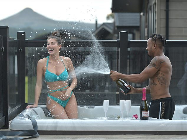 Champagne showers:The Love Island star, 21, and her former co-star, 27, put on a playful display while hanging out in a hot tub, as he showered her with a bottle of bubbly