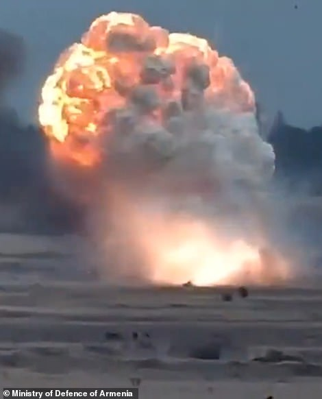 Armenian footage allegedly showing the remains of a helicopter bursting into flames on the battlefield