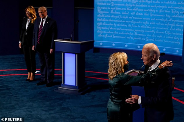 President Donald Trump and First Lady Melania Trump on stage during the debate, alongside Joe Biden and his wife Jill Biden