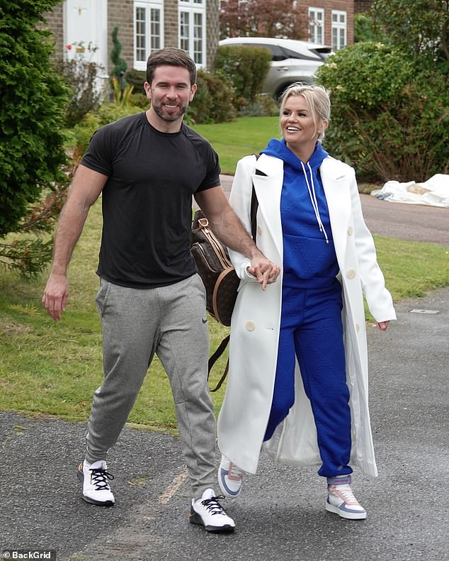 Romance: Kerry Katona, 40, looked on cloud nine as she showed off her engagement ring on a stroll with her fiancé Ryan Mahoney, 31
