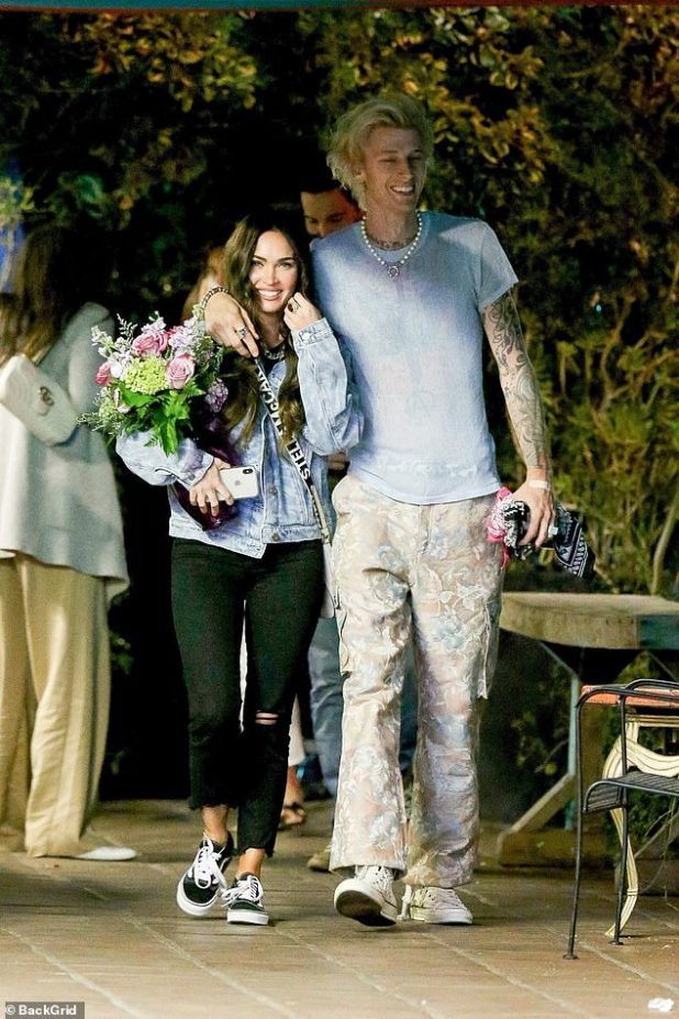 Just the two of us: Machine Gun Kelly bursts into laughter as she wraps her arms around Megan Fox after an Al Fresco dinner in Hollywood.