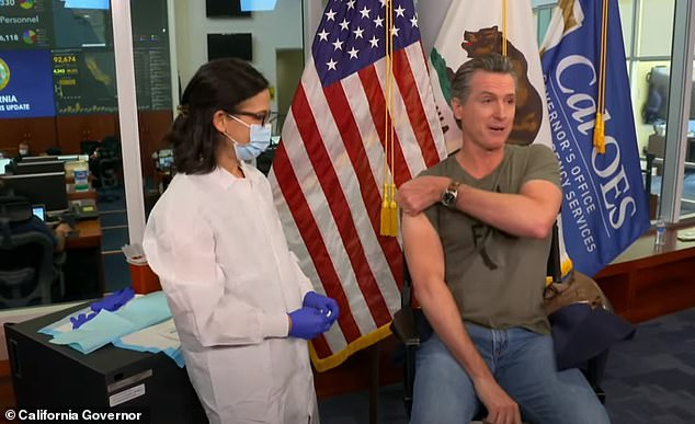 Newsom, 52, completed the 30-second process in front of the cameras to 'demonstrate how simple it is and how safe it is' as the flu season draws in