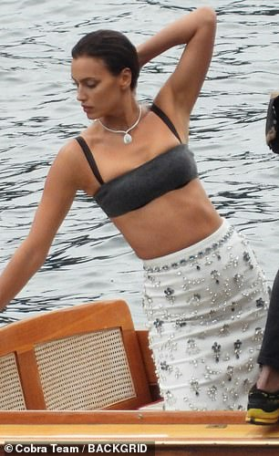 Versatile: A cropped grey top and a bedazzled cream skirt were also featured on set
