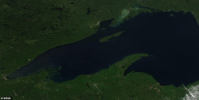 The vibrant colors are a result of vegetation losing chlorophyll, which is a molecule used to synthesize food and gives plants their green hue. However, the process requires sunlight and warm temperatures and as cold weather moves in during the fall, the amount of chlorophyll drops ¿ allowing other pigments to shine through. Pictured is Lake Supeiror during the summer months when the weather is much warmer