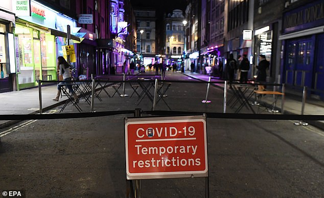 Sales in theaters last Friday were down 37% from the same day in 2019. Pictured: An empty street in Soho, London, just before the 10pm closing.