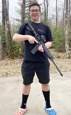 Attorneys for Kenosha shooter Kyle Rittenhouse (pictured) have accused Joe Biden of defaming the teenager after he was portrayed as a white supremacist in a video shared by the presidential nominee