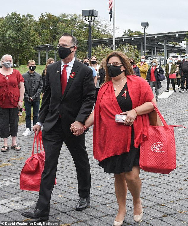 John and Alisa McMorris arrive at courthouse in Riverhead, New York, Wednesday morning f