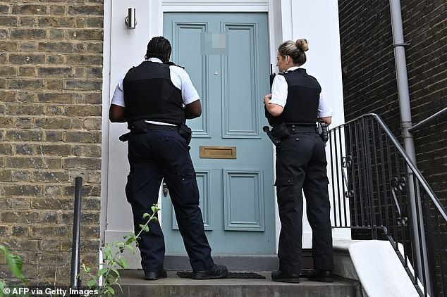 Police officers checking on tourists who should be quarantining after returning to the country abandon their search if no one answers the door twice (stock picture)