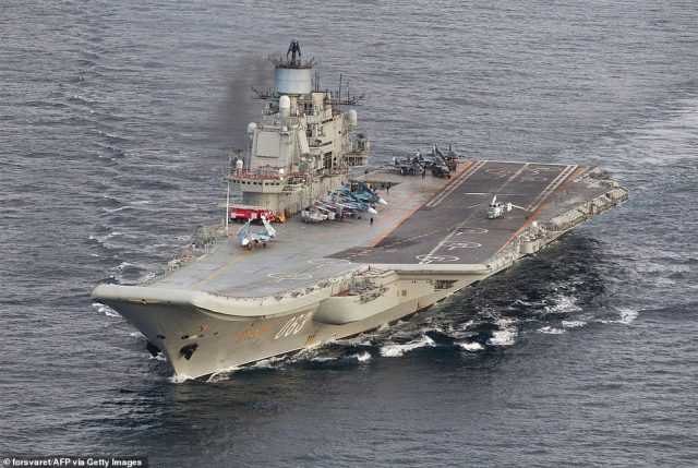Russia has only one aircraft carrier, the Admiral Kuznetzov (pictured), and analysts say improvements in the navy have been more 'patchy'