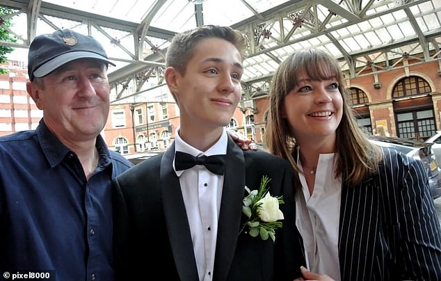 Loving family: Archie with parents Nicholas and Lucy