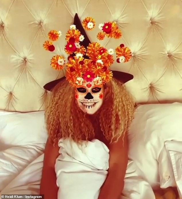 Day of the dead: Her digital makeup was a nod to Mexico's Dia De Los Muertos, covering her face with faux calavera makeup while marigolds spilled from her forehead