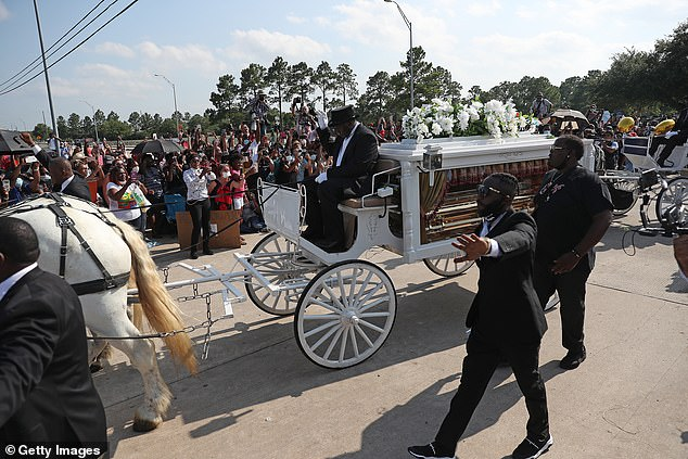 At least six sniper teams, an elite Border Patrol unit and a FBI surveillance aircraft were deployed at George Floyd's Texas burial, records show.People watch as a horse drawn hearse containing the remains of Floyd passes by during a funeral procession on June 9