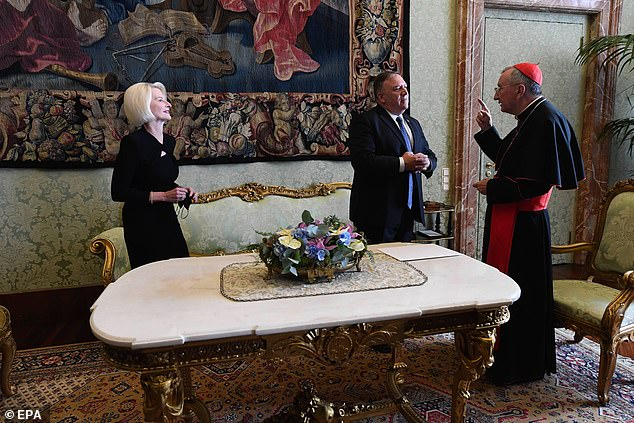 Trump's remarks come amid tension with his administration and the Vatican. Above, Secretary of State Mike Pompeo and U.S. Ambassador to the Holy See Callista Gingrich meet with Vatican Secretary of State Italian Cardinal Pietro Parolin