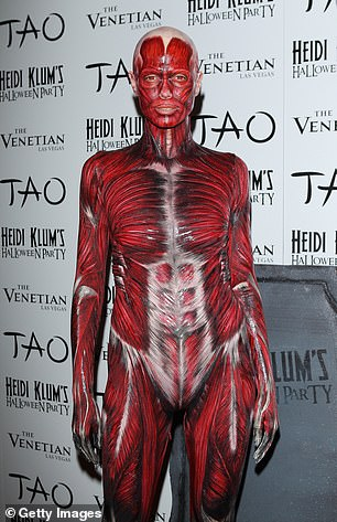 Body works: She's never shied away from a wild costume, seen as a human without skin during 2011 above