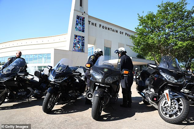 Houston police officers who had escorted the hearse with the casket of George Floyd stand outside of the Fountain of Praise church where his memorial and funeral services will be held on June 8