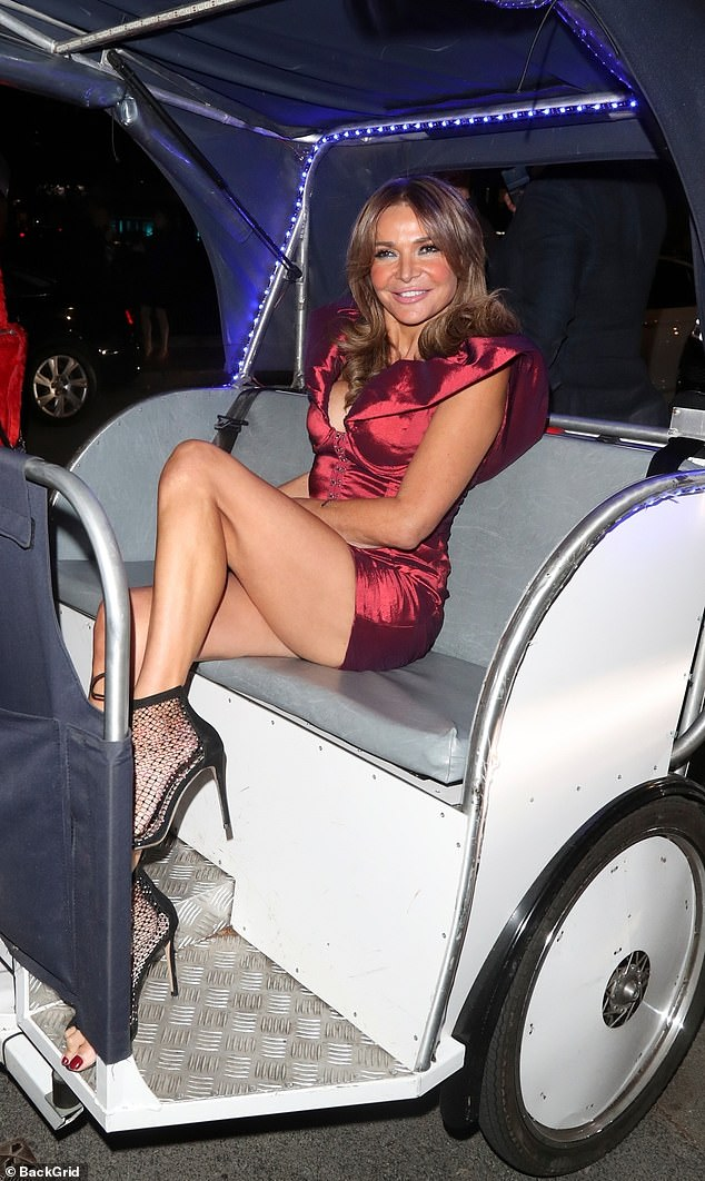 Chariots of fire!The WAG, 52, turned heads as she pulled up in her chariot for the evening - a tuk tuk