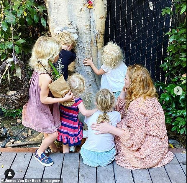 Sentimental: The actor posted a photo of Kimberly and their five children - Olivia, 10, Joshua, eight, Annabel, six, Emilia, four and Gwendolyn, two - gathered around a tree at the house they are moving from.
