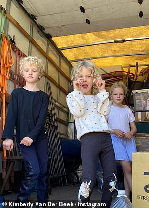 She shared a photo of her children from inside a moving van