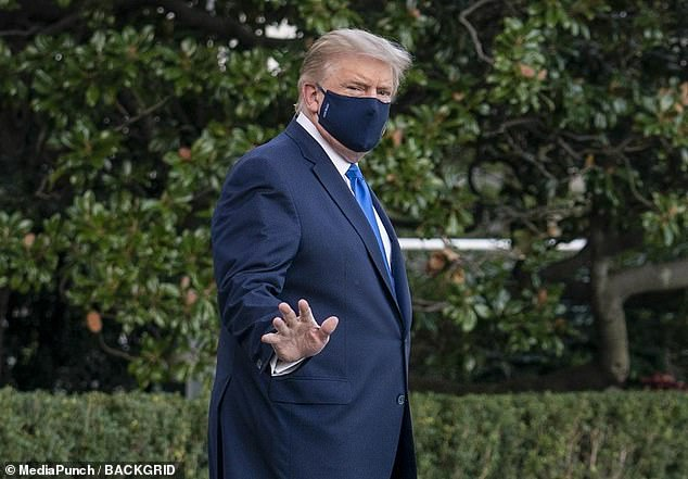 Moore claimed Trump was using a COVID-19 diagnosis as an excuse to try to postpone the election.  In the photo, Trump walks to Marine One to be rushed to hospital on Friday