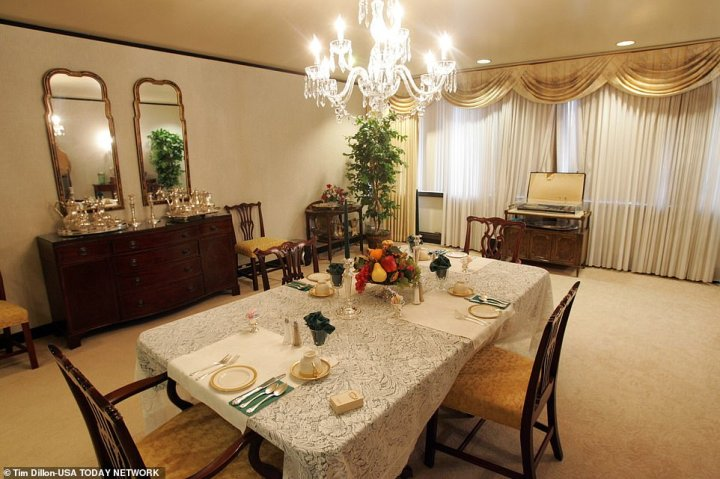 The dining room in the suite is even lit by a crystal chandelier, meaning Trump can be treated to the luxuries he's become accustomed to