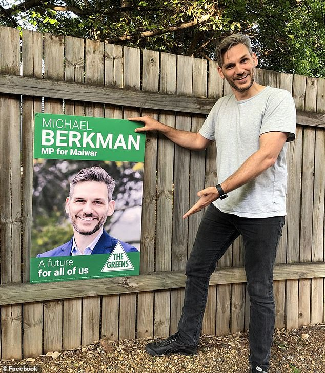 Michael Berkman from The Greens (pictured) said his supporters were not responsible for the graffiti and said his own signs had been graffitied with 'homophobic slurs'