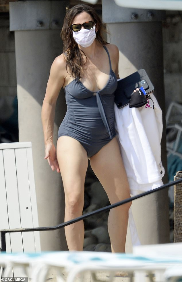 Beach chic: The 48-year-old donned a halter spaghetti-strap swimsuit, which was tied at her neckline, with gathers at the sides