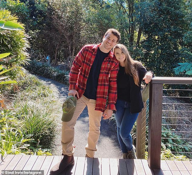Smitten: Bindi and Chandler are expecting their first child together next year, and the newlyweds are more in love than ever. Both in the photo