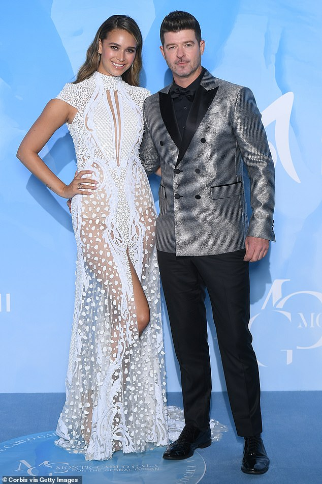 Growing family:In addition to their two daughters, her fiancé Robin Thicke also shares a son, 10-year-old Julian, with his ex-wife Paula Patton; pictured in September 2019