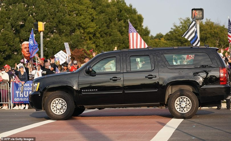 Trump surprised them Sunday night with a brief visit, waving from the SUV as it drove past